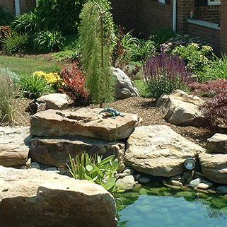 Featured Landscape: Ornamental Flower Stone Garden and Pond